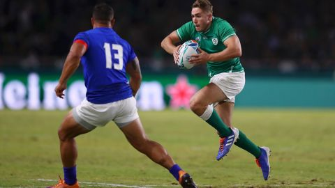 Jordan Larmour of Ireland runs with the ball towards Alapati Leiua of Samoa. The game took place in the west of Japan as a typhoon battered Tokyo some 1,100 kilometers away.