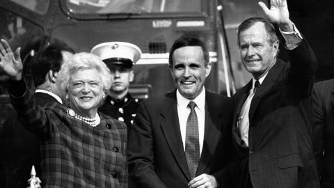 Giuliani greets US President George H.W. Bush and first lady Barbara Bush at a Wall Street heliport in September 1989. Giuliani, who had resigned as US attorney, was running for mayor of New York. He lost a close race to David Dinkins that year, but the two would face off again four years later.