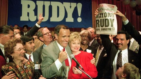 Giuliani hugs his wife, Donna, after defeating Dinkins in a rematch in 1993.