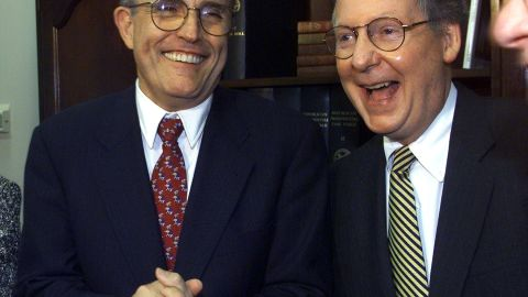 Giuliani shares a laugh with US Sen. Mitch McConnell at a Republican fundraiser in Washington in April 1999.