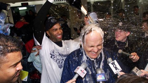 Giuliani gets doused with champagne after the New York Yankees won the American League pennant in October 2000.