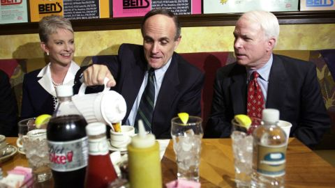 Giuliani pours coffee as he has breakfast with US Sen. John McCain and McCain's wife, Cindy, in April 2000. McCain came to New York to campaign for Giuliani, who was running for a US Senate seat. Giuliani dropped out of the race after announcing that he had prostate cancer and wanted to focus on treatment.