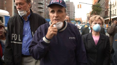 Giuliani tours the World Trade Center site with New York Gov. George Pataki and US Sen. Hillary Clinton in September 2001.