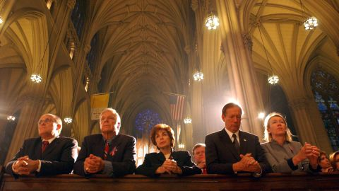 Giuliani, left, prays at St. Patrick's Cathedral a few days after the September 11 attacks. At right is New York Gov. George Pataki and his wife, Libby.