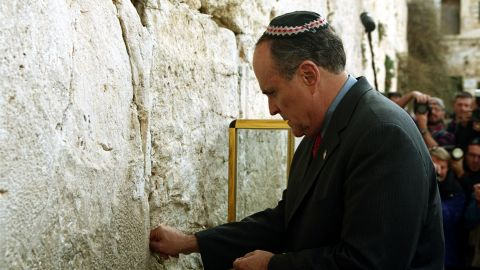 Giuliani touches the Western Wall, Judaism's holiest site, in December 2001. He was visiting as part of a delegation that included Pataki and Mayor-elect Michael Bloomberg.