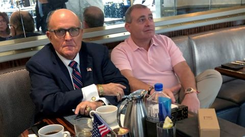 """Giuliani has coffee with Ukrainian-American businessman Lev Parnas at the Trump International Hotel in Washington in September 2019. A few weeks later, Parnas and another Giuliani associate, Igor Fruman, <a href=""""https://www.cnn.com/2019/10/12/politics/giuliani-trump-ukraine-russia-impeachment-inquiry/index.html"""" target=""""_blank"""">were indicted on criminal charges</a> for allegedly funneling foreign money into US elections."""