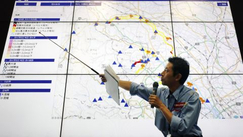 A land ministry official explains effects of Typhoon Hagibis on rivers in Saitama Prefecture during a press conference in Saitama city, near Tokyo, on October 12.