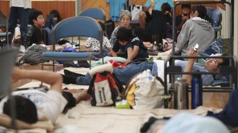 Evacuees gather in a junior high school gymnasium in Shizuoka, Japan, on October 12.