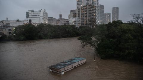 A café is submerged in floodwater from the Tama River in Tokyo on October 12.