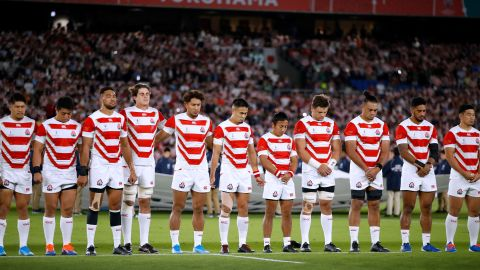 Japan's players line up for a minute of silence for the victims of Typhoon Hagibis prior to their match against Scotland. At least 15 people were killed and 140 are missing after Japan's worst storm in decades.
