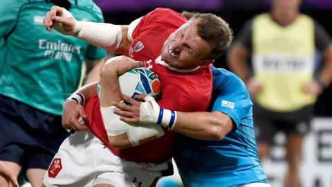 Wales' centre Hadleigh Parkes is tackled.