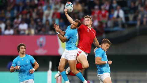 Hallam Amos of Wales and Gaston Mieres of Uruguay jump for a high ball. Wales beat Uruguay 35-13, qualifying them for a quarterfinal match against France.