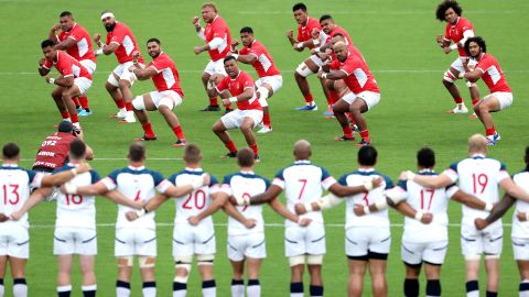 The Tonga players perform the Sipi Tau prior to the Group C game between USA and Tonga at Hanazono Rugby Stadium in Osaka, Japan on Sunday.