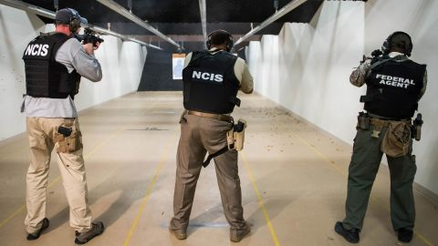 NCIS special agents fire the MK18 gun during range qualifications.