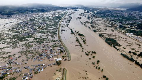 Residential areas are submerged in muddy waters after an embankment of the Chikuma River broke in Nagano, Japan, on Sunday, October 13.