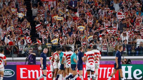 Japan supporters celebrate their team's third try  during the Japan 2019 Rugby World Cup Pool A match between Japan and Scotland at the International Stadium Yokohama in Yokohama on October 13, 2019. (Photo by Odd ANDERSEN / AFP) (Photo by ODD ANDERSEN/AFP via Getty Images)