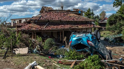 An upturned car lies next to a partially destroyed house after being hit by a tornado shortly before the arrival of Typhoon Hagibis, on October 13 in Chiba, Japan.