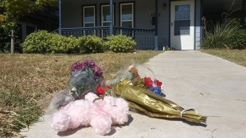 Mourners left flowers in front of the house where 28-year-old Atatiana Jefferson was killed.