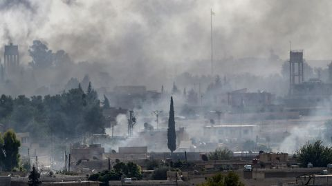 AKCAKALE, TURKEY - OCTOBER 13: Smoke rises over the Syrian town of Tel Abyad, as seen from the Turkish border town of Akcakale on October 13, 2019 in Akcakale, Turkey. The military action is part of a campaign to extend Turkish control of more of northern Syria, a large swath of which is currently held by Syrian Kurds, whom Turkey regards as a threat. U.S. President Donald Trump granted tacit American approval to this campaign, withdrawing his country's troops from several Syrian outposts near the Turkish border. (Photo by Burak Kara/Getty Images)