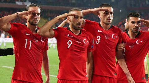 Turkish players perform a military salute after Cenk Tosun's winning goal against Albania.