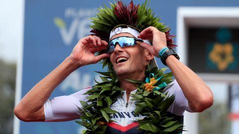 Jan Frodeno celebrates after winning the Ironman World Championships in Kailua Kona, Hawaii.