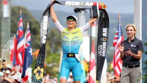 Anne Haug celebrates after winning the Ironman World Championships in Kailua Kona, Hawaii.