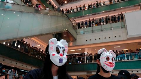 """Protesters wearing masks in defiance of <a href=""""https://www.cnn.com/2019/10/04/asia/hong-kong-face-mask-ban-meeting-intl-hnk/index.html"""" target=""""_blank"""">a recently imposed ban</a> gather at a shopping mall on October 13."""
