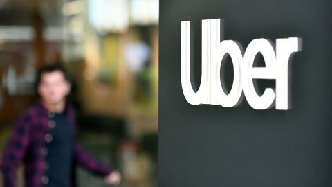 An Uber logo is seen on a sign outside the company's headquarters location as people protest nearby in San Francisco, California on May 8, 2019. - One of the early promises of the ride-hailing era ushered in by Uber and Lyft was that the new entrants would complement public transit, reduce car ownership and help alleviate congestion. But a new study on San Francisco has found the opposite may be in fact be true: far from reducing traffic, the companies increased delays by 40 percent as commuters ditched buses or walking for mobile-app summoned rides. (Photo by Josh Edelson / AFP)        (Photo credit should read JOSH EDELSON/AFP/Getty Images)