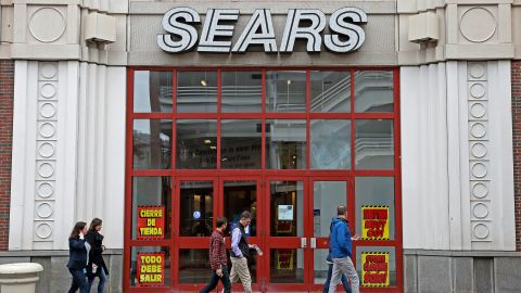 CAMBRIDGE, MA - OCTOBER 15: Pedestrians pass the entrance to the closing Sears store at the CambridgeSide Galleria in Cambridge, MA on Oct. 15, 2018. Signs for a going-out-of-business sale began appearing in the stores windows last week, and a CambridgeSide spokeswoman said it is set to close in December. That move could help boost an even larger project that CambridgeSide owner New England Development has been planning in recent months. It includes office space and housing along First Street, where the Sears and the malls massive garage now stand. (Photo by David L. Ryan/The Boston Globe via Getty Images)