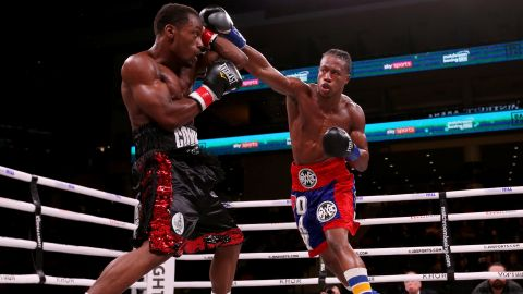 Patrick Day (R) lands a punch on Charles Conwell in the third round of their super-welterweight fight.