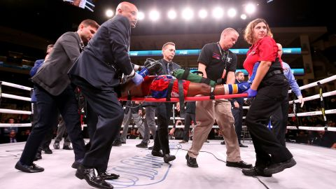 Day is stretchered out of the ring after being knocked out by Conwell.