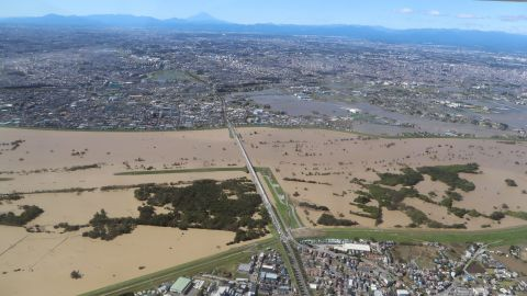 This aerial view shows the swollen Arakawa river in the aftermath of Typhoon Hagibis dividing Tokyo and Saitama prefecture on October 13, 2019.