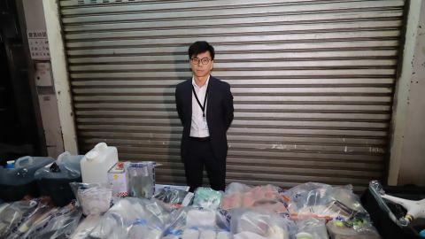 Hong Kong Police Superintendent Raymond Chou shows objects seized in a raid on October 15, 2019.