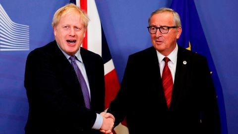 British Prime Minister Boris Johnson (L) shakes hands with President of the European Commission Jean-Claude Juncker as they prepare to address a press conference at a European Union Summit at European Union Headquarters in Brussels on October 17, 2019. (Photo by Kenzo TRIBOUILLARD / AFP) (Photo by KENZO TRIBOUILLARD/AFP via Getty Images)