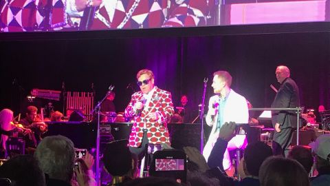 Elton John and the actor who played him in ìRocketmanî Taron Egerton sing after the Hollywood Orchestra played along to the movie.