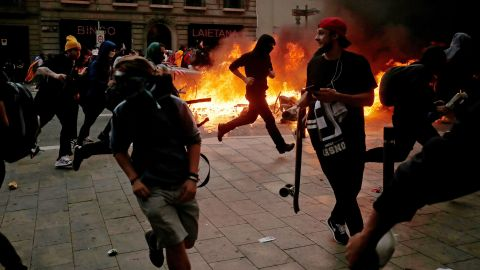 Protesters clash with police in central Barcelona on Friday.