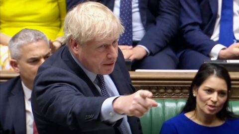 """Brexit. Prime Minister Boris Johnson delivers a statement in the House of Commons, London, to update the House on his new Brexit deal after the EU Council summit, on what has been dubbed """"Super Saturday"""" . Picture date: Saturday October 19, 2019. The House of Commons usually sits from Monday to Thursday, and on the occasional Friday. But on Saturday October 19 there will be an extraordinary sitting of Parliament - the first on a weekend since April 1982 - to discuss Boris Johnson's new Brexit deal. See PA story POLITICS Brexit. Photo credit should read: House of Commons/PA Wire URN:47572249 (Press Association via AP Images)"""