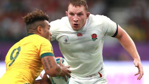 Sam Underhill of England looks to tackle Will Genia of Australia their quarterfinal match. England won 40-16.