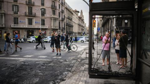 Members of the public view the damage on Saturday after the night of rioting in Barcelona.