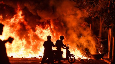 Fires burn in Barcelona on Friday  following another evening of protests