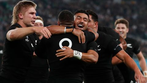 New Zealand's scrum-half Aaron Smith (C) is hugged by New Zealand's fly-half Richie Mo'unga (2nd R) after scoring a try during the Japan 2019 Rugby World Cup quarter-final match between New Zealand and Ireland at the Tokyo Stadium in Tokyo on October 19, 2019. (Photo by Odd ANDERSEN / AFP) (Photo by ODD ANDERSEN/AFP via Getty Images)