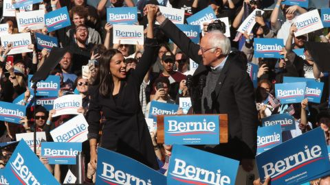 Rep. Alexandria Ocasio-Cortez, D-N.Y., clasps hands with Democratic presidential candidate Sen. Bernie Sanders, I-Vt., after introducing Sanders during a campaign rally on Saturday, Oct. 19, 2019 in New York. (AP Photo/Mary Altaffer)