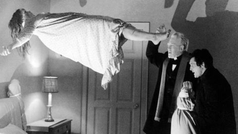Left to right: Linda Blair as Regan MacNeil, Max von Sydow as Father Merrin, and Jason Miller as Father Karras in 'The Exorcist', directed by William Friedkin, 1973.