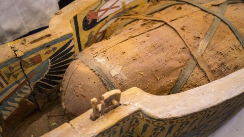 An open coffin displayed in Luxor reveals a mummy.
