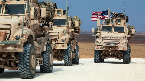American military convoy stops near the town of Tel Tamr, north Syria, Sunday, Oct. 20, 2019. Kurdish-led fighters and Turkish-backed forces clashed sporadically Sunday in northeastern Syria amid efforts to work out a Kurdish evacuation from a besieged border town, the first pull-back under the terms of a U.S.-brokered cease-fire. (AP Photo/Baderkhan Ahmad)