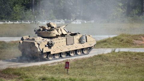 """A Bradley Fighting Vehicle assigned to A Co., 3rd Battalion, 15th Infantry Regiment, 2nd Armored Brigade Combat Team, advances to the first berm to fire at Fort Stewart, Ga., Sept. 25. BFV Crews qualified on the 25mm Bushmaster cannon turret and the coaxial 7.62mm machine gun in the last opportunity for crew gunnery certification before the 2ABCT deployment for """"Defender 2020.""""  (U.S. Army Photo by Spc. Jordyn Worshek, Released)"""