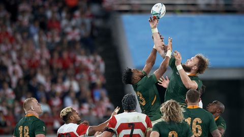 Lukhanyo Am (C) of South Africa jump for the balls during a lineout.