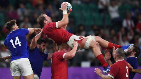 Wales' lock Alun Wyn Jones (C) catches the ball.