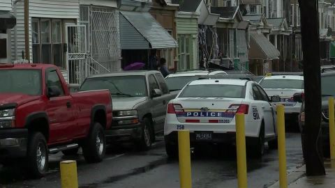 A 2-year-old girl was killed and two adults wounded when someone fired into a house Sunday, police said.