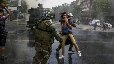 A demonstrator is detained by the police during a protest in Santiago, Chile, on Saturday.